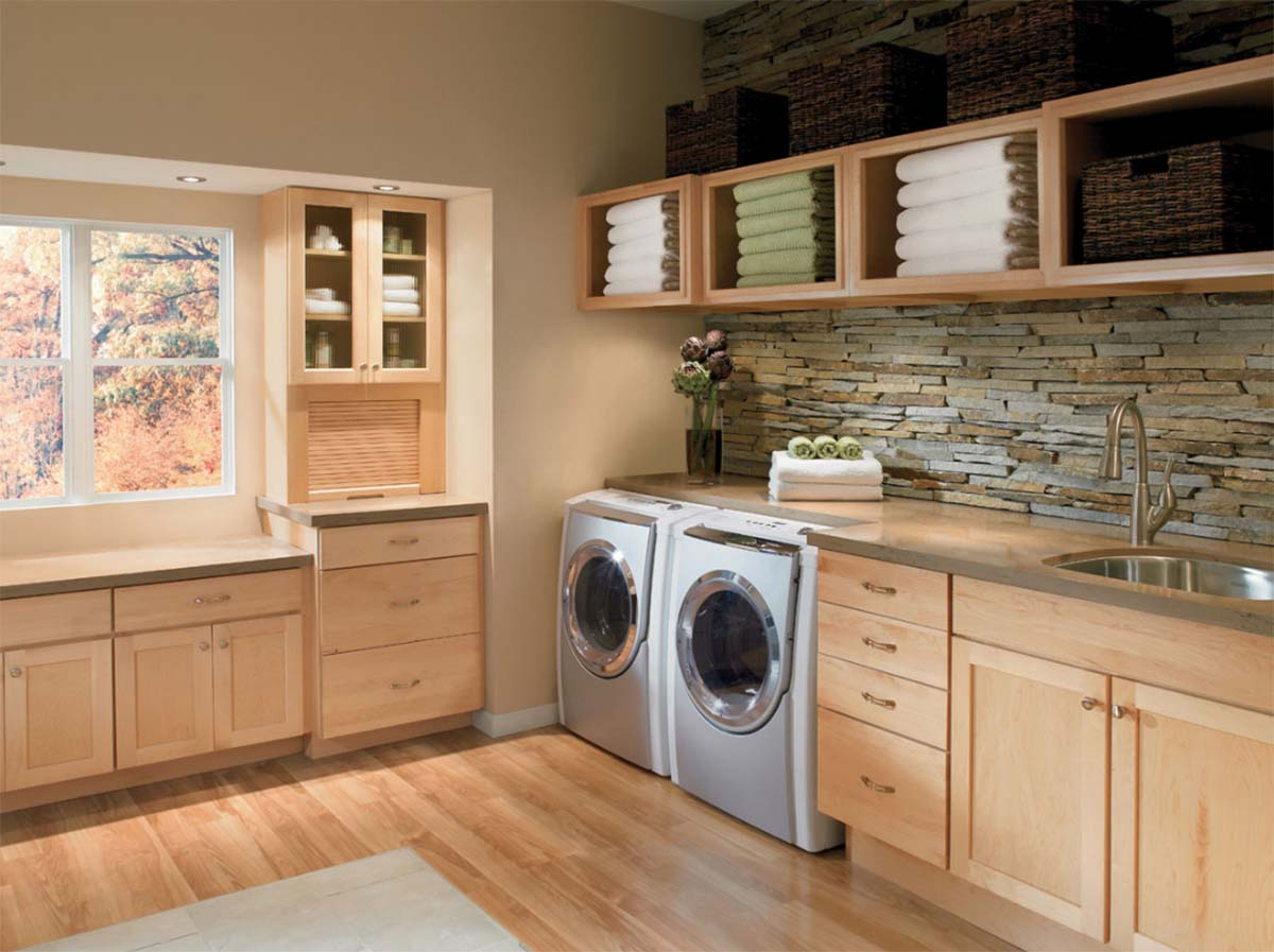 Laundry room cabinets are shown in 410 Maple Natural.