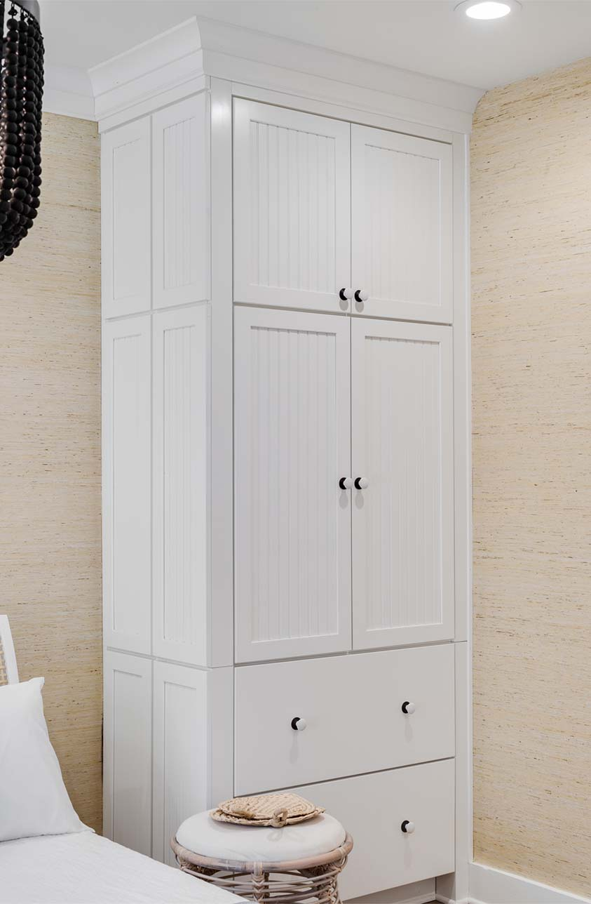 This floor-to-ceiling armoire has a smaller footprint than traditional dressers and bureaus. Shown with door style 644 Painted Linen.