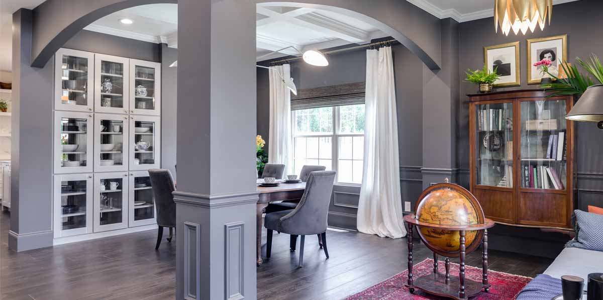 View from the dining room into the kitchen. Cabinet door style shown in 650 Painted Stone. Goes great with our Evolved Elegance style. Take our style quiz to find yours.