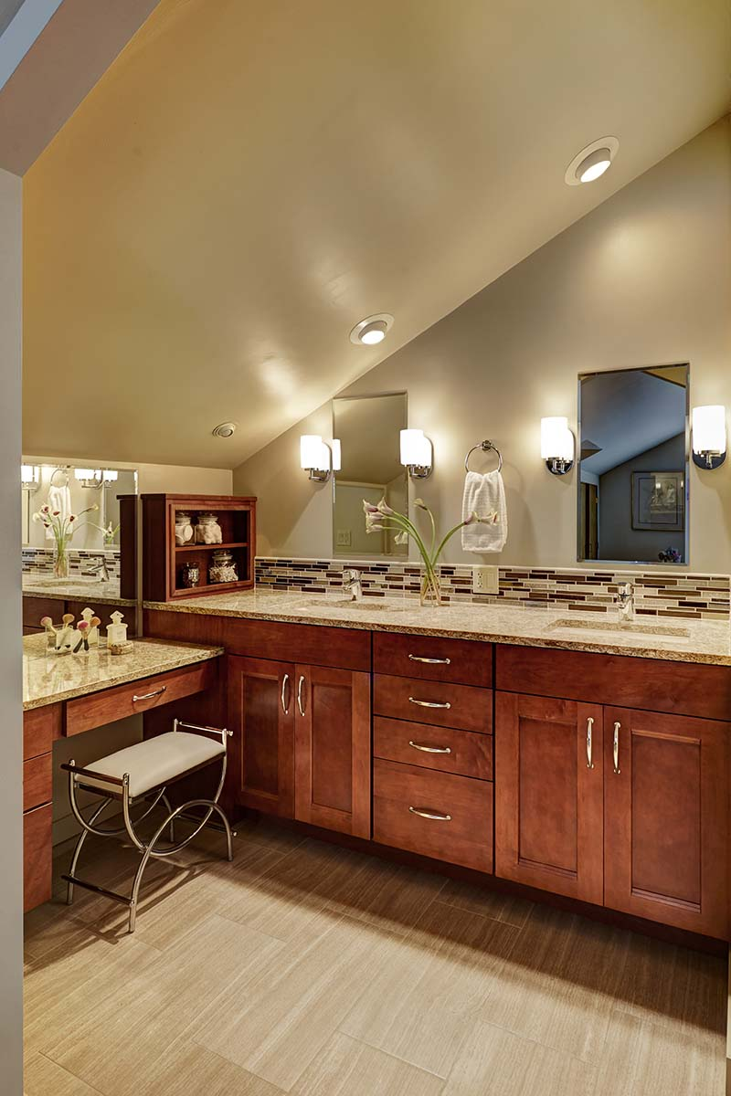 A vanity was added under the sloped ceiling to make use of the space and create more much needed storage.