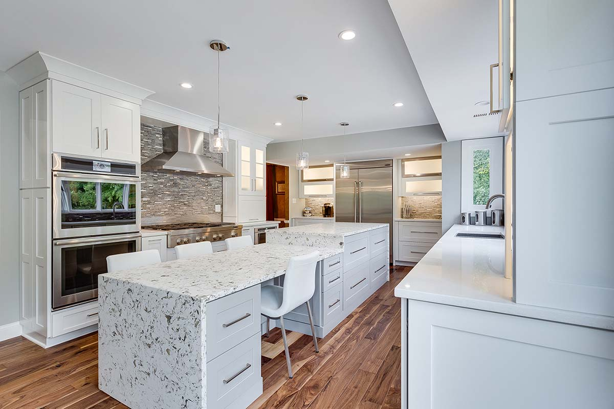 This kitchen island with waterfall countertop adds a dramatic sculptural detail.