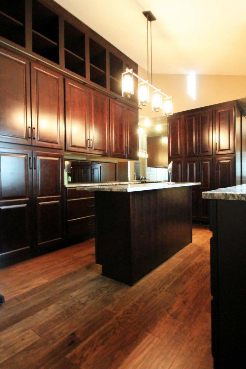 The cabinetry conceals most of the clothing giving the area an organized look that's easy to maintain.